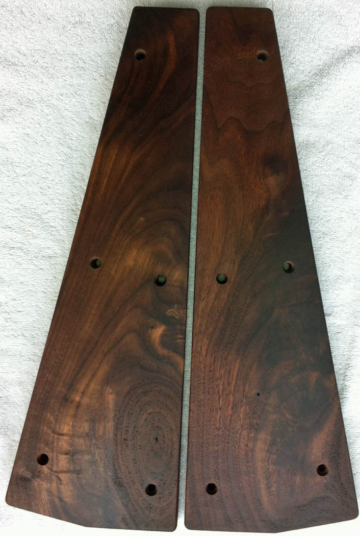 Ornate walnut end pieces.jpg